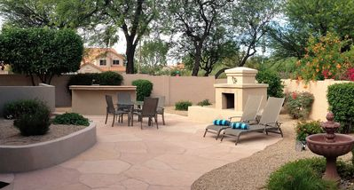 Your large private Flagstone Patio with new water feature, Kiva and built in BBQ