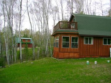Guest cabin w/small living area, kitchen, bath on lower level; bunkroom upstairs