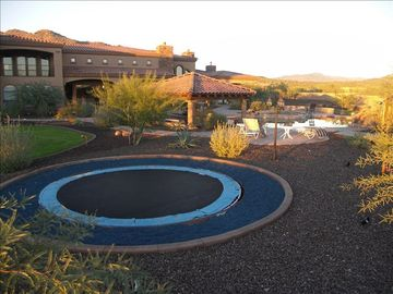 This home has everything. Backyard Built-in Trampoline and 3 horseshoe pits.