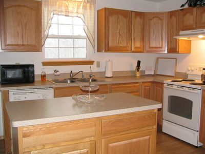 The large kitchen is fully equipped.
