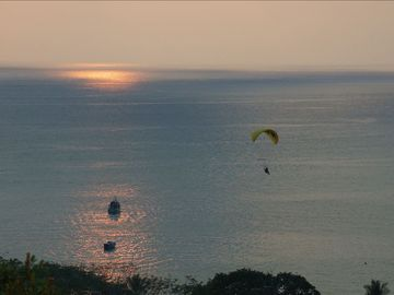 A peaceful sunset, watching a glider over the bay