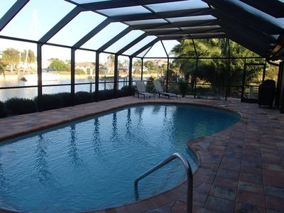 enclosed lanai with swimming pool and grill