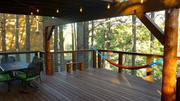 Flagstaff cabin rental - Peeled Ponderosa Pine Poles support the Large Balcony and create the ambiance.