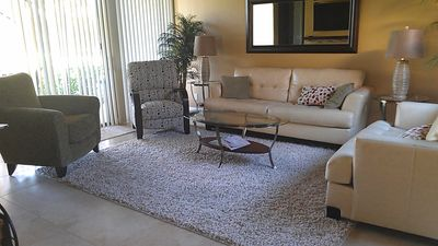 Cream leather sofa & loveseat. Two easy chairs for relaxing.