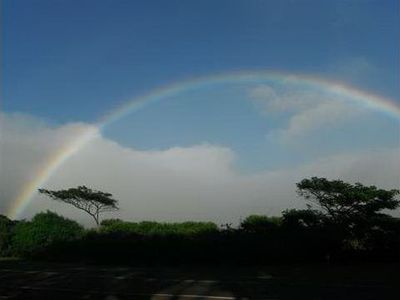 Rainbow looking north across Poipu Rd. from Waikomo