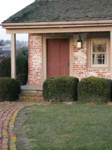 The brick walk leads to thie romantic historical cottage.