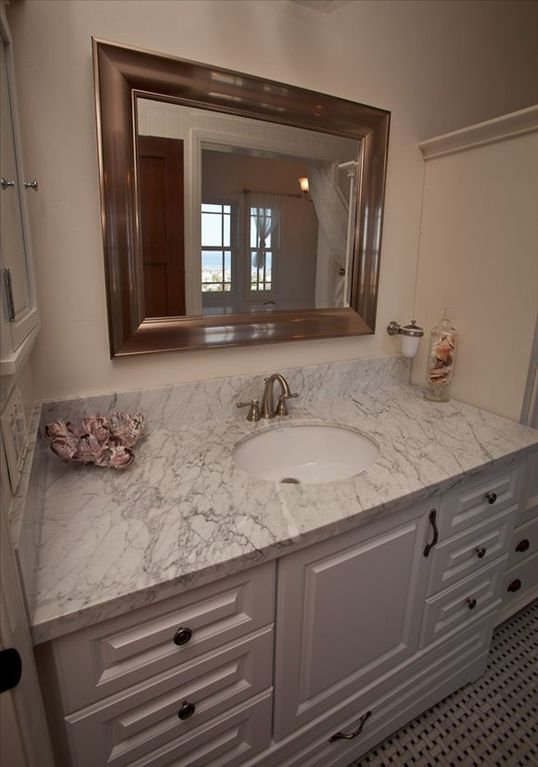 Upstairs Master bathroom with double vanity marble sinks.