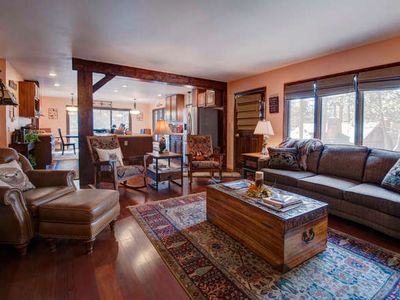Spacious livingroom/kitchen area furnished in rustic elegance.