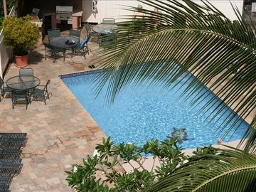 Pool, shaded area and BBQ within steps. Great grounds crew keep things tidy.