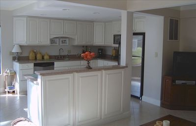 newly renovated kitchen with granite counter tops, island and new appliances