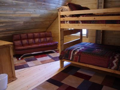 The loft upstairs has a bunk bed and a futon