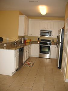 Kitchen remodeled in 2011 with granite countertops, stainless steel appliances.