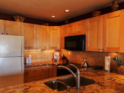 Kitchen-granite counters,all new appliances,custom maple cabinets,etc.