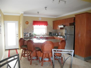 Fully equipped kitchen with breakfast nook.