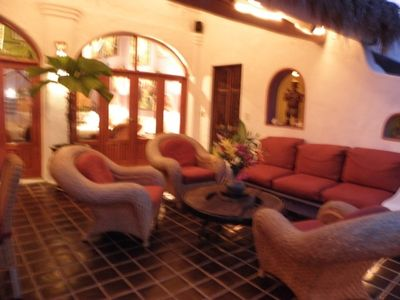 Huge Comfortable Terrace at night off Main Living Room great Entertainment Area.