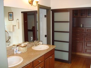 Henderson house photo - Main master bath and closet w/built-in hutch dresser. 2nd master has similar.