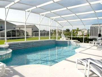 South Facing 40ft x 40ft SunDeck, Pool & Spa with luxury furniture, and Lanai.