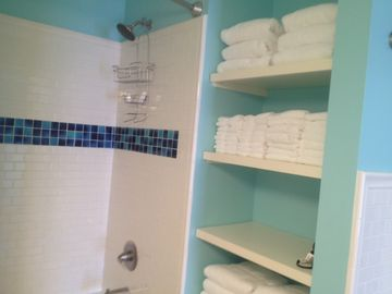 New bath towels and shelving space to keep your toiletries while you stay!