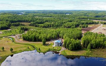 Big Lake estate rental - Ariel view of house and property. 200 acres and 2 mile walking trail.
