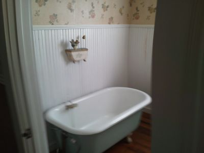 Second bathroom on ground floor with an antique soaking bathtub.