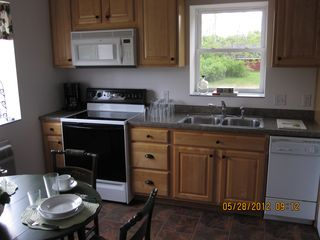 Munising cottage photo - A kitchen for all your cooking needs. Fully stocked and a view of Lake Superior