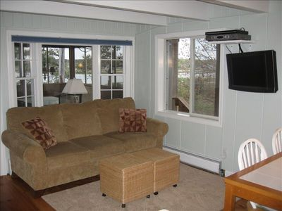 Living room with slider to screened porch, views, HDTV, oversized chairs