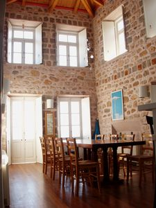 Main dining room with doors opening on to the breakfast terrace