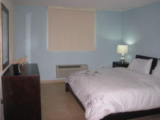 Aguadilla apartment photo - Master bedroom with confortable king size bed, walking closet and A/C.