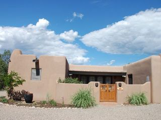 Santa Fe house photo - Main entrance to the house is off the street around the back. Park 4 cars easy.