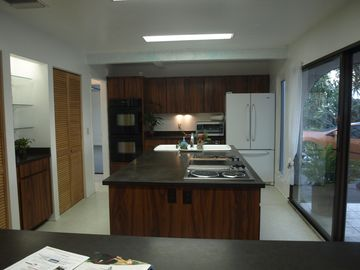 The kitchen has a grill, cooking isle, 2 ovens,dishwasher, filtered water & ice