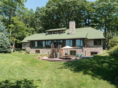 View of the house from the west facing Lake Michigan featuring porch and deck.