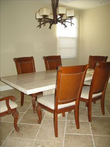 Spacious separate dining room with large stone table