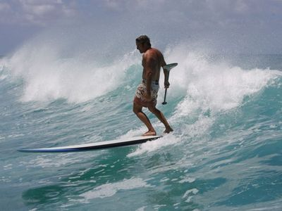 Take an easy paddle or try surfing the waves while stand up paddling!