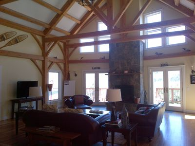 bright, spacious and beautiful post & beam craftsmanship with 24' ceiling