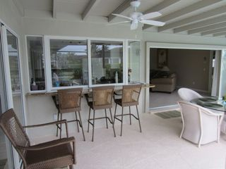 Vacation Homes in Marco Island house photo - Bar seating and open pocketing sliding glass doors