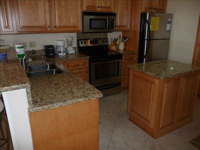 Beautiful new kitchen with granite countertops, SS appliances, & lots of storage