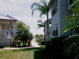 Port Charlotte condo photo - Walkway to pool clubhouse to the left.