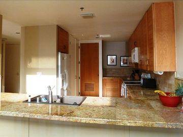 New granite countertops and new fixtures in the well-appointed kitchen.