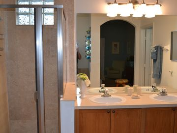 Master Bathroom 1 with upgraded travertine tile.