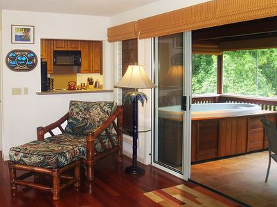 Riverhouse: The hot tub overlooks the river from the lanai. Feel the romance?