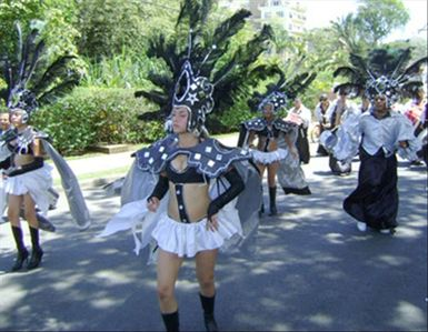 A samba band and parade kick off the annual arts festival in Jacó.