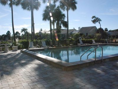 The beautiful community heated pool is conveniently located two houses down.