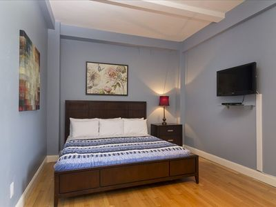 Bedroom #2: Big bed, modern furniture, flat screen TV, custom paintings