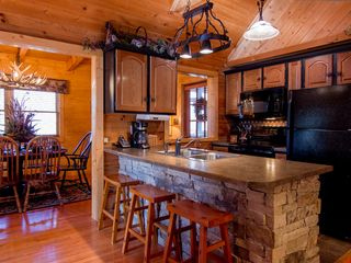 Pigeon Forge cabin photo - kitchen with breakfast bar for entertaining while making dinner