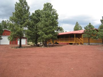 Williams cabin rental - Gorgeous secluded lot on a lush 3 acres. Big Barn/Garage to store all the toys.