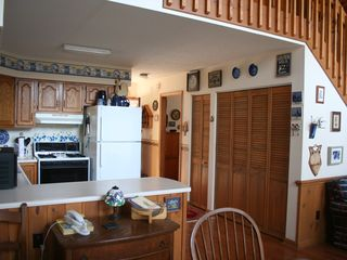 Bryson City chalet photo - Fully equipped kitchen with washer and dryer behind those doors!