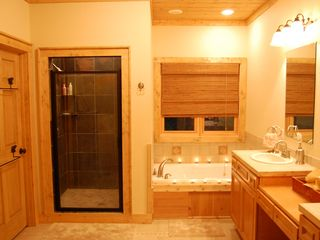 Cashiers house photo - Master Bath on main with two vanities, stone shower, jetted tub & walk-in closet