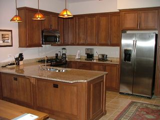 Gourmet Kitchen with dishwasher, microwave, stove - Sandpoint condo vacation rental photo