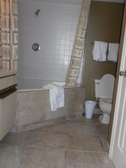 Garden City Beach condo photo - Master bath with large garden tub and shower