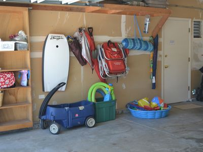 Clean garage with parking for 1 car, organized beach supplies & 2 bikes.